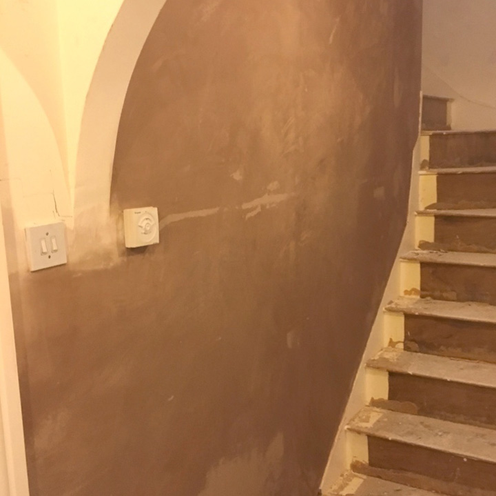 During the plastering and rendering work for the stairway.