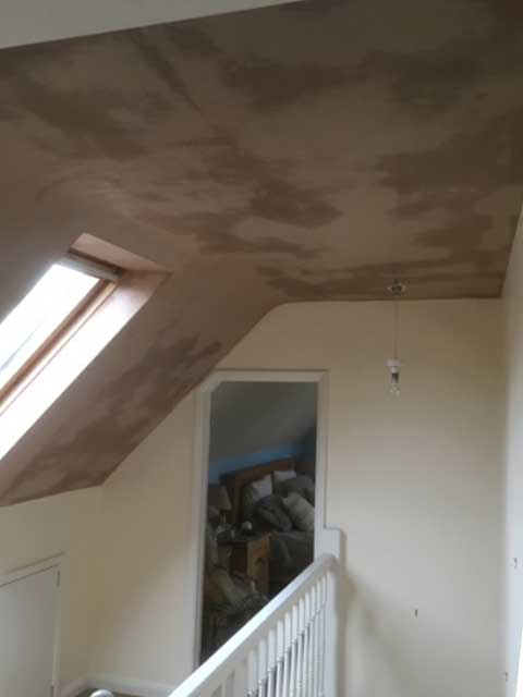 Completed plastering on a roof.