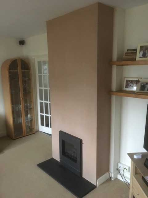 Completed plastering of a fire place.
